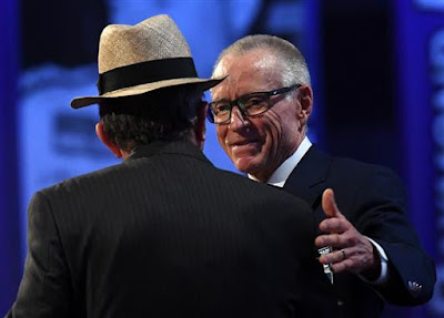 Mark Martin reaches out to Jack Roush during his induction into the NASCAR Hall of Fame.