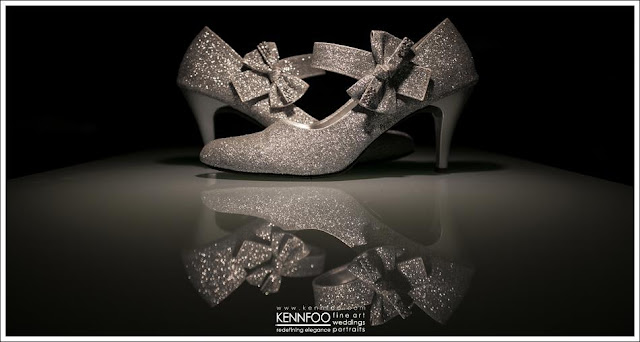 artistic display, facing each other, reflection of the shoes on wedding