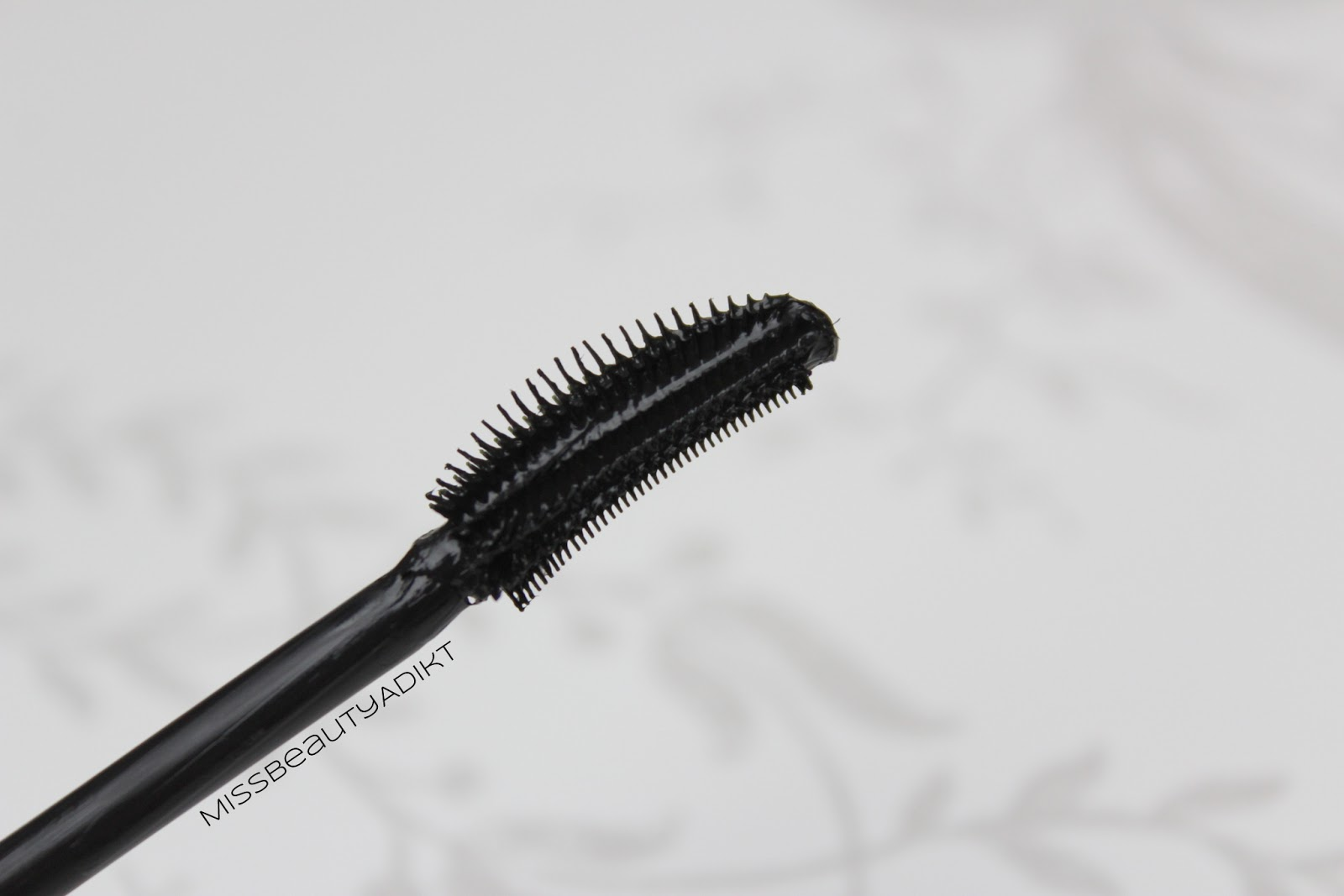 d601d2890aa This mascara does remind me of the L'Oreal False Lash Flutter, with the  curved mascara wand. On the inner part of the wand, the bristles are very  densely ...