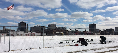 Volunteers brave snow and cold to help keep Navin Field clean, even in the dead of winter
