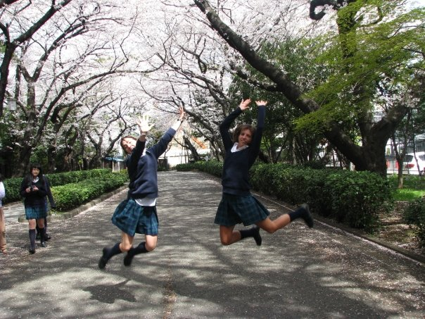 Jumping school girls My friend Allyson and I celebrating sakura at the International School of Sacred Heart -April 2005