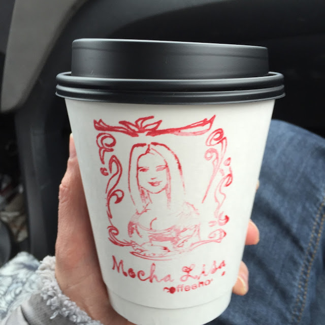 Mocha Lisa coffee cup