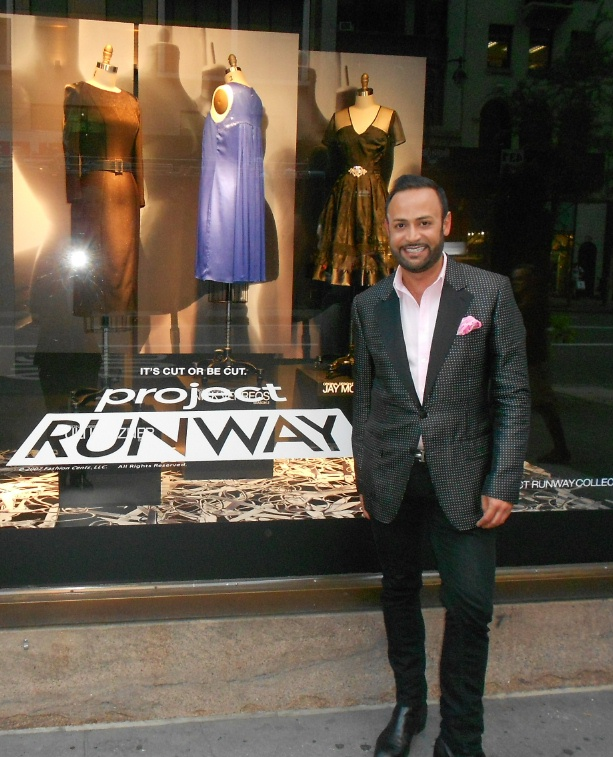 566d0bcc7f8 Fifth Avenue Boy  Nick Verreos posing in front of the Project Runway Lord    Taylor Collection Window Display (violet-blue dress design in the  background by ...