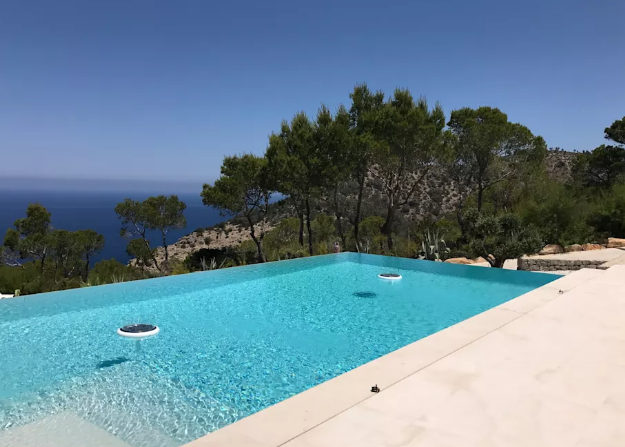 An infinity pool on the hill side of the sea