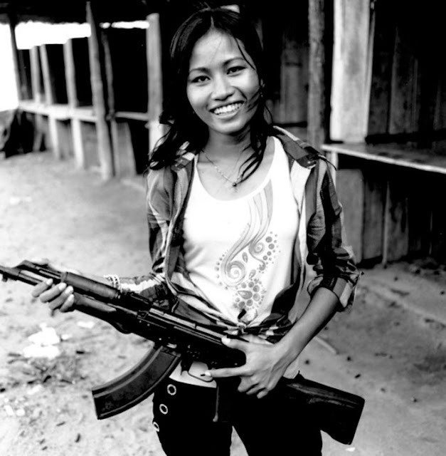 Smiling Girl with AK47