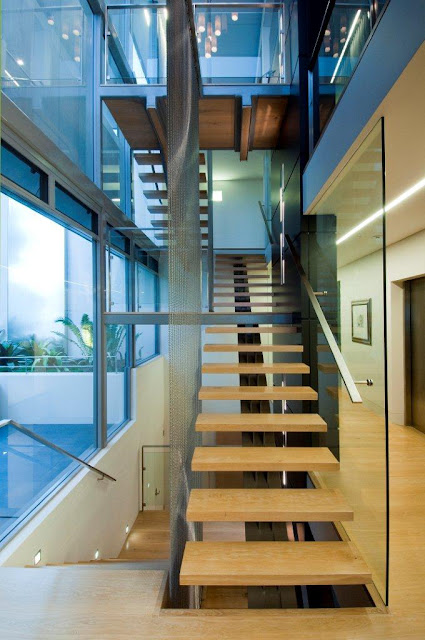 Photo of modern staircase leading to the first floor and the basement in an amazing home in Sydney, Australia