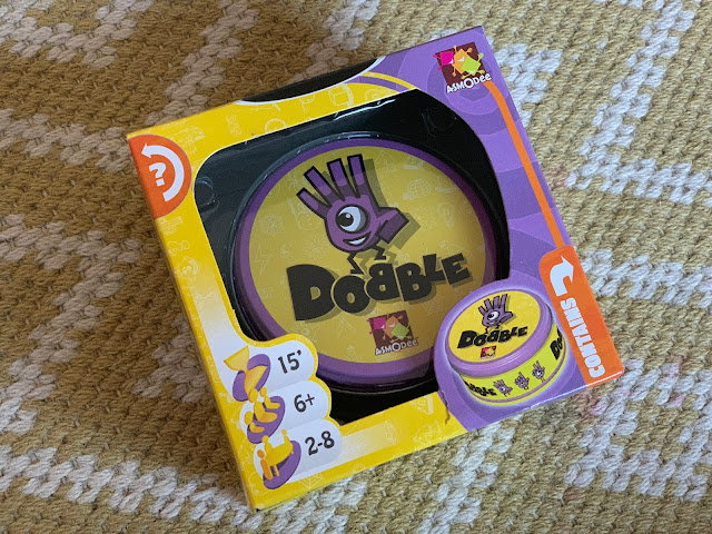 The original Dobble family card game in packaging