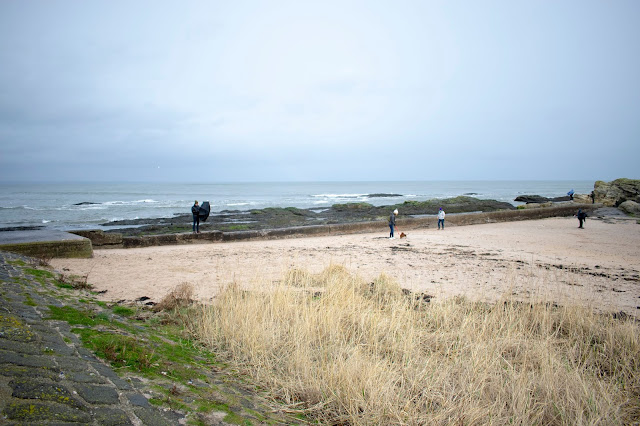 St Andrews beach with people on sand and water