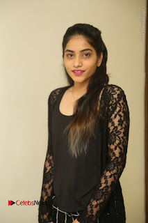 Actress Punarnavi Bhupalam Stills in Black Dress at Pittagoda Press Meet  0019.JPG