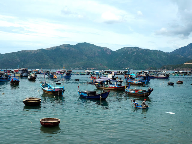 Traditional fishing boats moored by one of the islands near Nha Trang, Vietnam