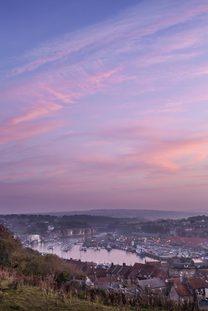 Image of Whitby town and harbour at sunset by Martyn Ferry Photography