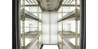 interior of biological environmental chamber with shelves and lighting
