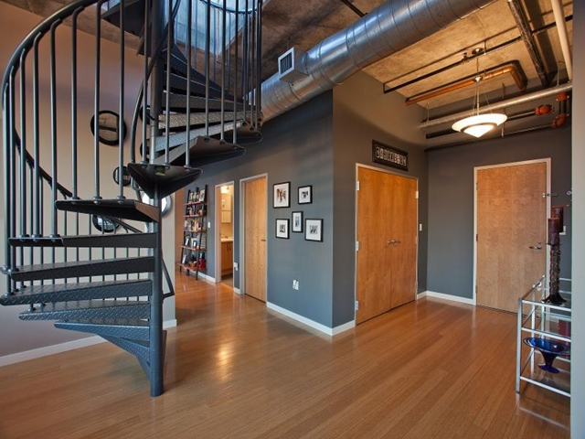 Entrance hallway and round staircase to the rooftop terrace in Denver penthouse apartment, Colorado
