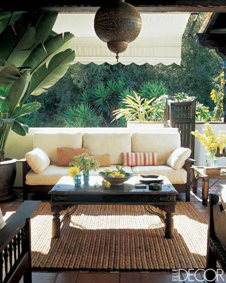 tropical and neutral garden sitting area