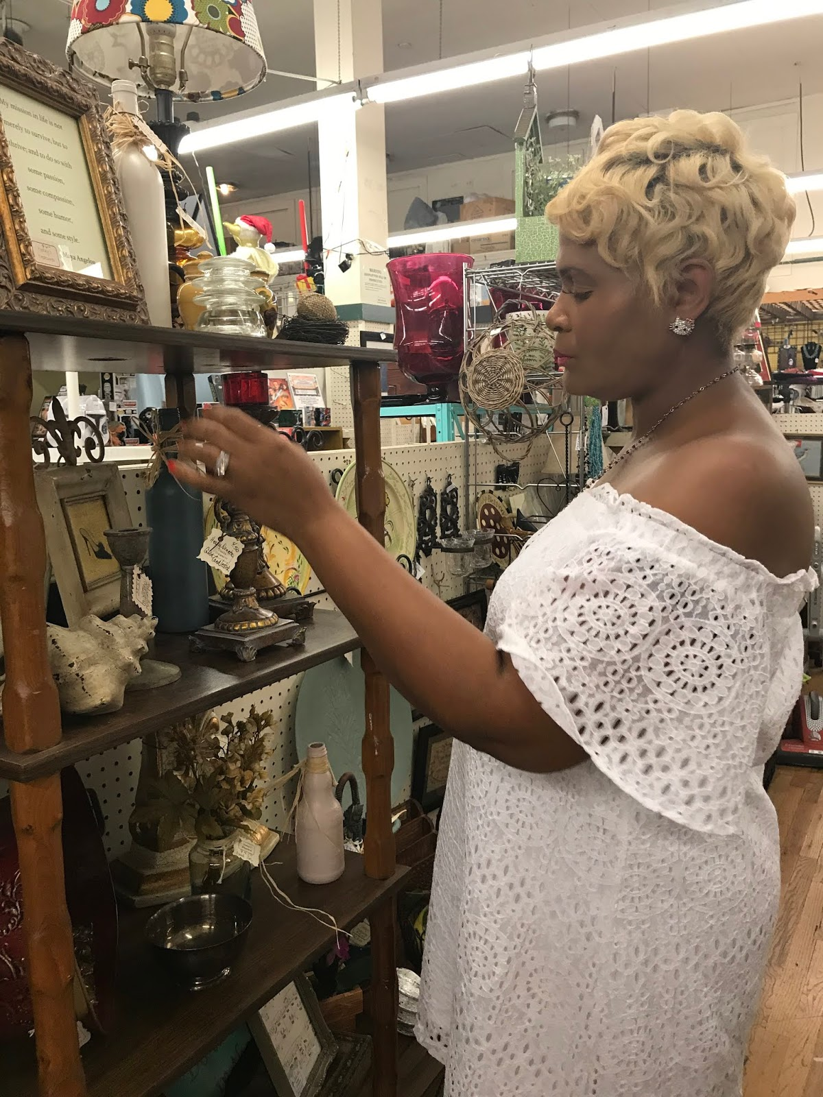 Image: Tangie Bell shopping in thrift store. If I only knew I was going to need more guidance and understanding as I age, I would've paid more attention to every year I let slip by after 20-something. #midlifenotes