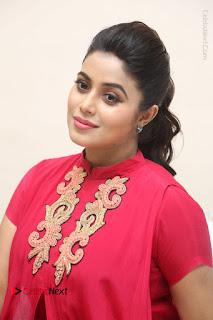 Actress Poorna Latest Stills in Red Dress at Rakshasi First Look Launch  0228.JPG