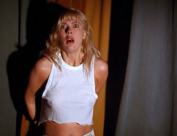 Am I crazy, or does Karen Mayo-Chandler's t-shirt get more skimpy as the  opening scene progresses? Anyway, after taking a swim, college co-ed,  Laurie Glazer ...