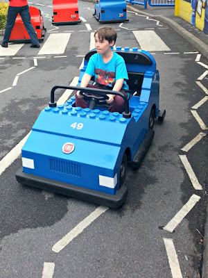 Boy driving a Lego car on the course at Legoland