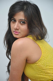 Actress Harshika Poonacha Stills in Yellow Short Dress at Appudala Ippudila Movie Promotions  0006.jpg