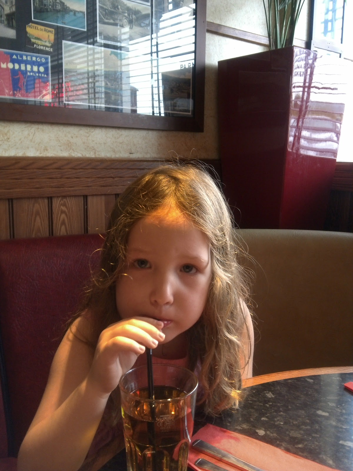Caitlin drinking apple juice at Frankie & Benny's