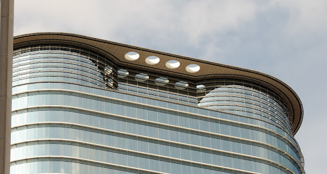 Top of curved Chevron Tower with four sky holes