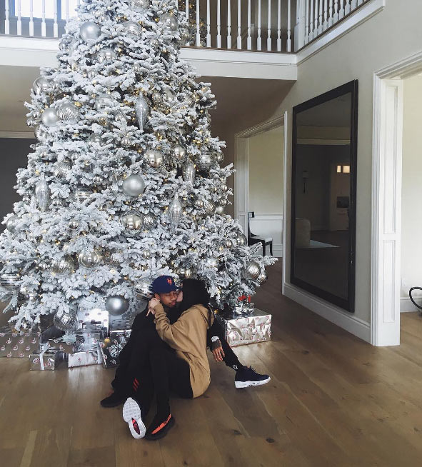 Kylie Jenner and boyfriend Tyga light up their Christmas tree with romantic cuddle