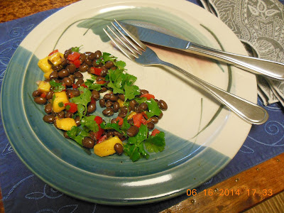 Black beans and mango made into a delicious salad.