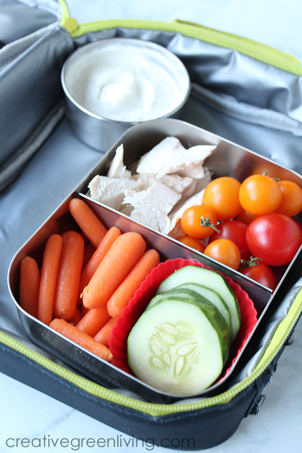 Make a tasty gluten free bento box lunch with carrots, cucumbers, tomatoes and chicken chunks with a high protein ranch dip made with Wallaby greek yogurt