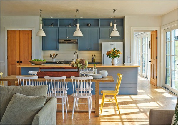 Modern farmhouse kitchen with blue painted cabinets and rustic wood doors found on Hello Lovely