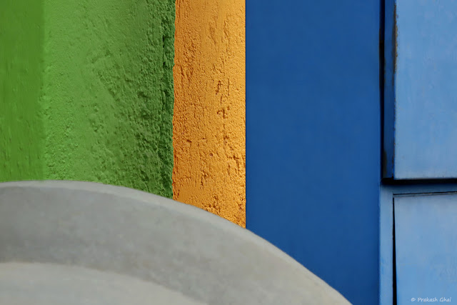 A Colorful Minimal Art Photograph of a Colorful Wall Sections shot near Tea Tradition Cafe Jaipur