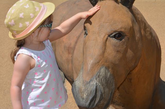 petting horse statue
