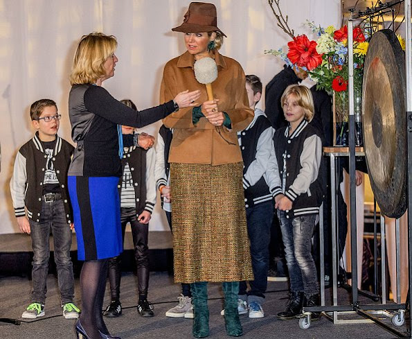 Queen Maxima wore Camel coat, Natan earrings, Lk Bennett boots, Fabienne Delvigne hat, Natan Skirt