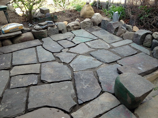 Reclaimed slate backyard patio Artist and Builder laying out slate complete