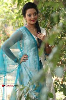 Tamil Actress Koushika Stills in White Salwar Kameez at Inayathalam Tamil Movie Audio Launch  0009.jpg