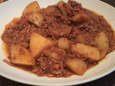 Slow Cooker Bolognese and Potato Hash cooked ingredients in a bowl