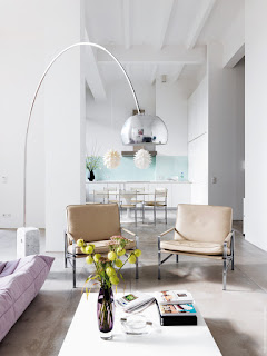 modern silver arch floor lamp combined with white coffee table plus flower centre piece ideas