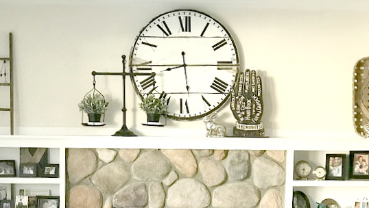 Mantel with clock, scale and ladder