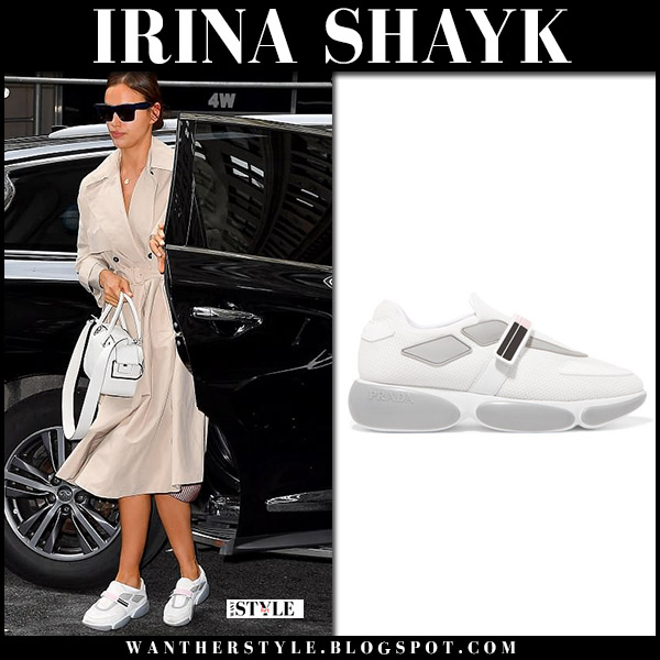 Irina Shayk in beige trench coat and white sneakers prada model style may 22