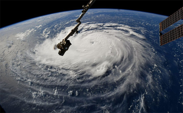 image of the unfathomably huge, swirling hurricane viewed from the International Space Station