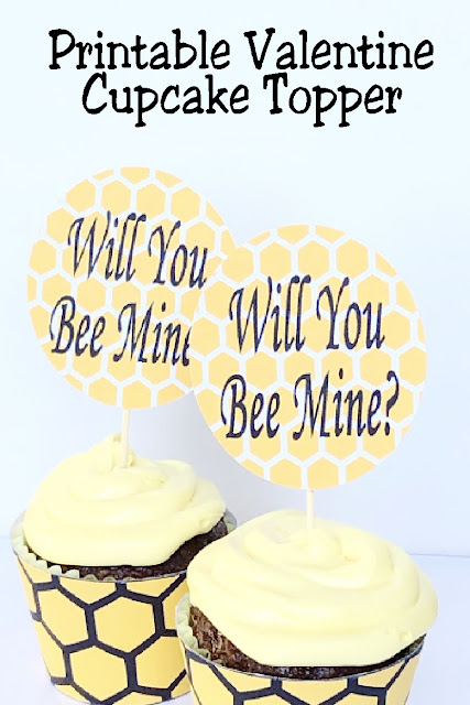 "Turn regular cupcakes into something amazing for your Valentine party with some printable valentine cupcake toppers. This ""Will You Bee Mine"" topper is a simple and fun way to add a little bit of fun to your dessert table.  #cupcaketopper #valentinecupcake #printablevalentine #diypartymomblog"