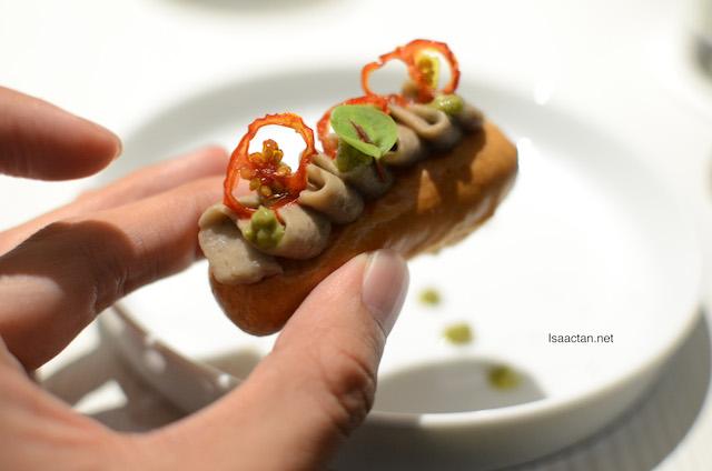 Gruyere Flavoured Pate a Choux topped with creamy Aubergine Caviar, Green Chile Pesto, and Tomato Confit