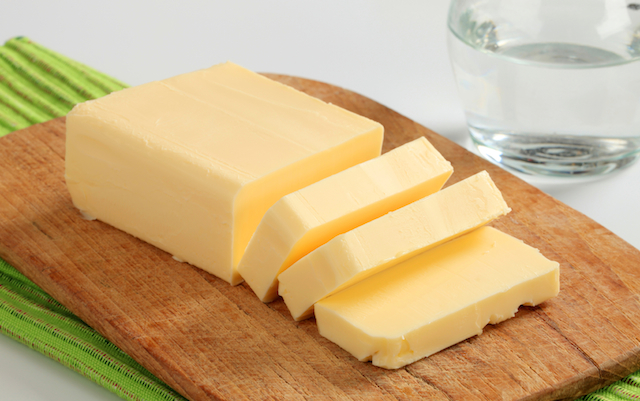 Butter is made from cream, whereas margarine is made by processing vegetable oils and may contain unhealthy trans fats and chemicals.