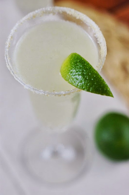 Champagne Margaritas Garnished with Lime image