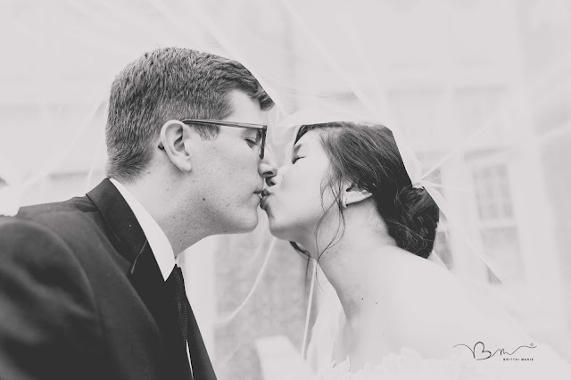 under the veil kissing photo at Grosse Point Academy