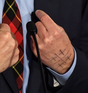 What were those symbols written on Tom Steyer s hand?