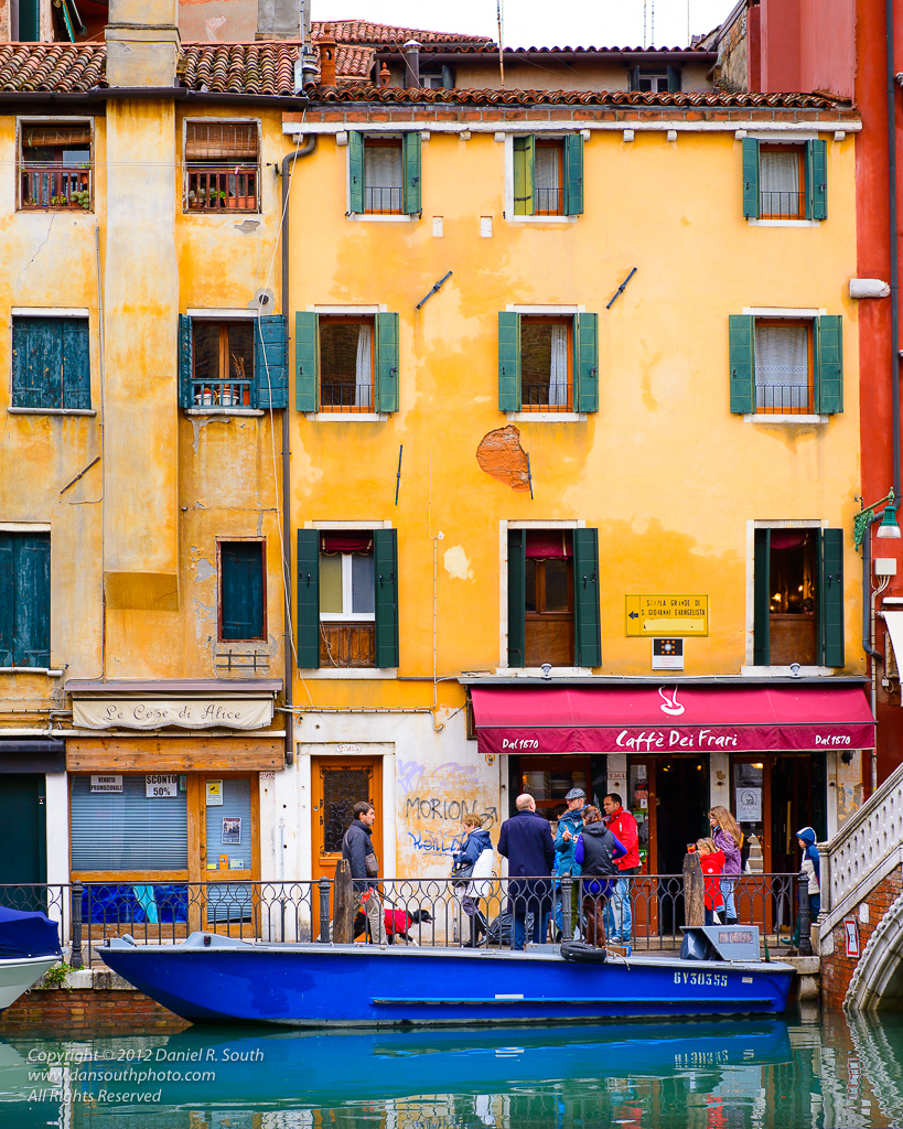 a caffe on a quiet canal in venice