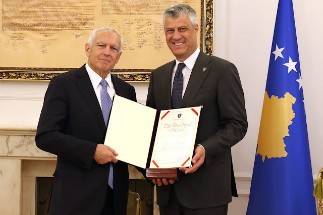 Wesley Clark is decorated with the Presidential Medal by Kosovo's Prime