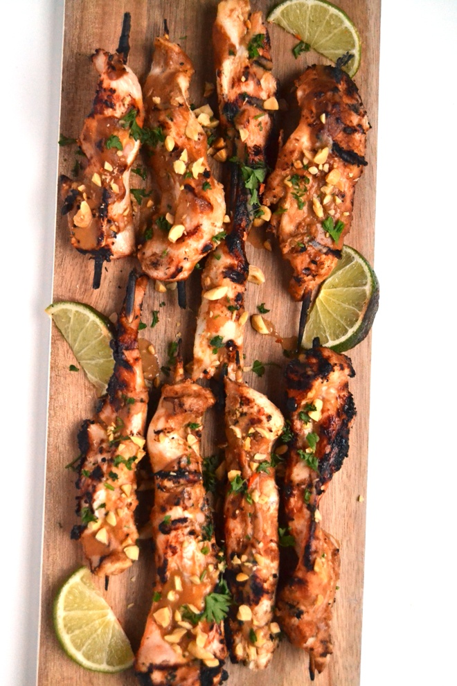 Chicken Satay with Peanut Sauce take 20 minutes to make and is rich in delicious grilled flavors and a tangy peanut sauce! www.nutritionistreviews.com