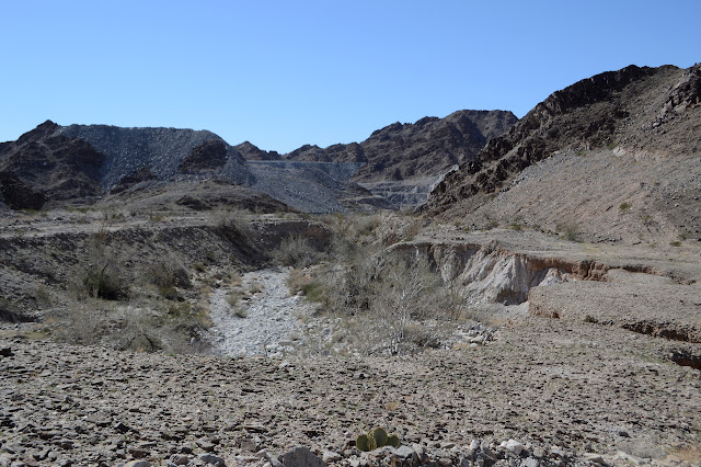 look down the wash to see the open pit