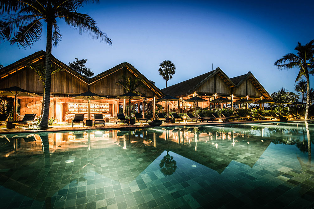 perfecting the balance between five star luxury and local authenticity the design of phum baitang hotel is a contemporary take on traditional cambodian